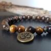 bracelet mixte homme femme bronzite oeil de tigre AUM tibétain